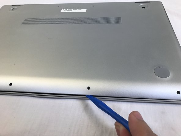 Use a plastic opening tool to pry open the case. Go slowly around the edge.  You will hear popping noises, such are due to popping open the small joints that keep the cover attached.