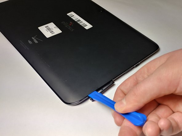 Start using the iFixit Opening Tool in the SD/SIM area to release the clips holding the back panel on.