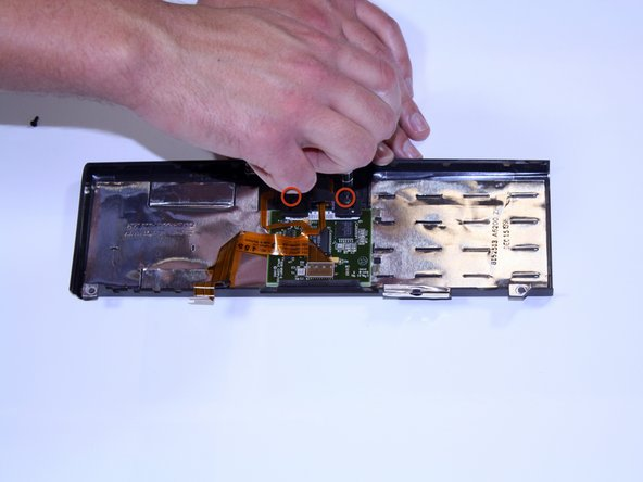 Unscrew the two torx #8 screws holding the mouse button in place.