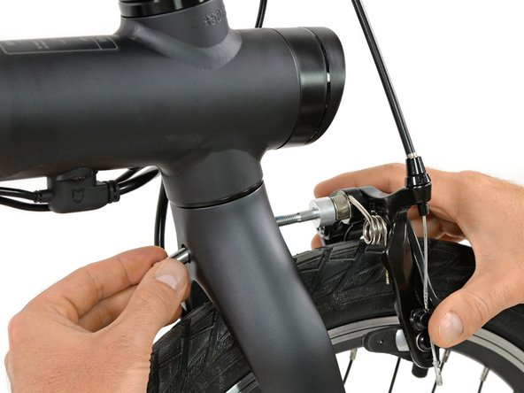 Back to something more mechanical we unmount the front brake—a standard dual-pivot side-pull caliper brake.