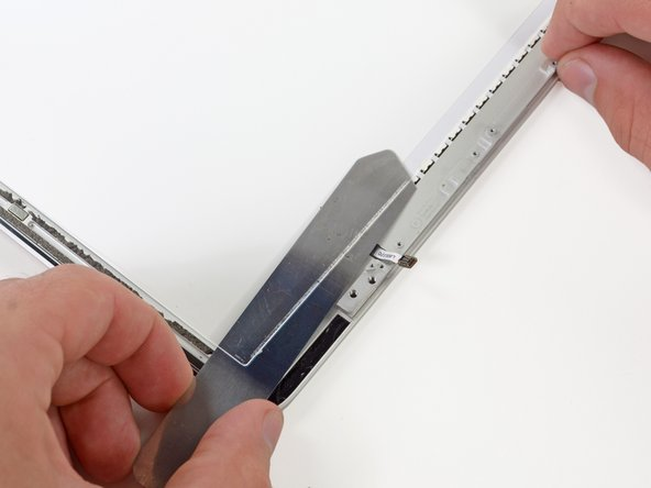 The light guide plate is held down by a small strip of mild adhesive—nothing like we saw before.