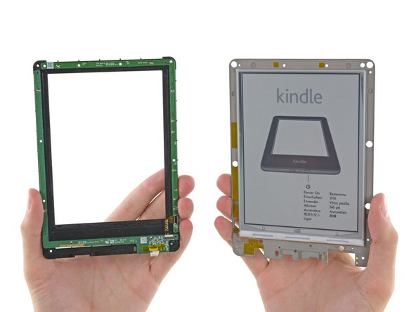 Returning to the front of the display assembly, we pop off a plastic bezel and find a secret perimetric circuit board.