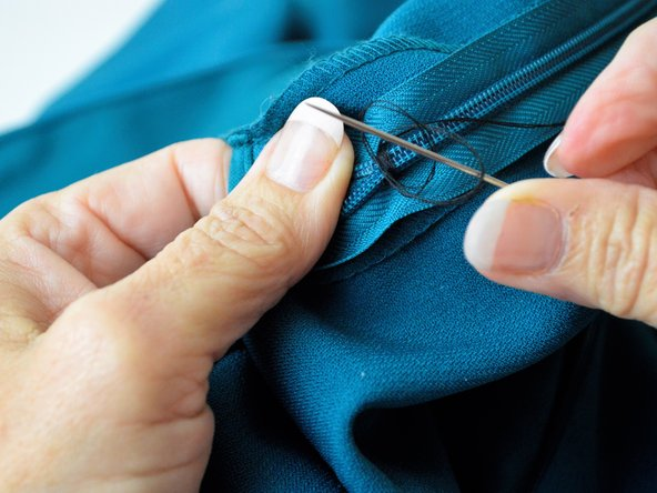 Tie off what has been sewn by making a knot in the thread.