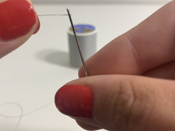 Thread the  needle  with the polyester thread.