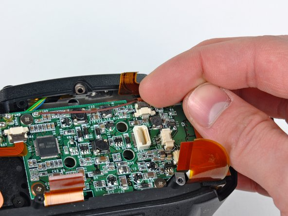 Use your fingernail to carefully flip up the ZIF cable retaining flap for the ribbon cable socket near the front cover.