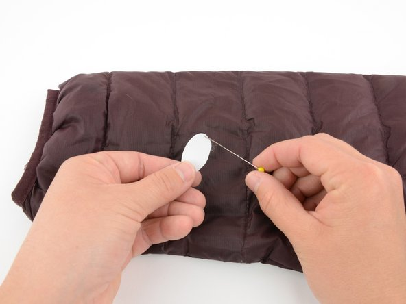 Using your fingernail, or a pin, peel the backing off the repair tape, so that you only have the clear sticky layer.