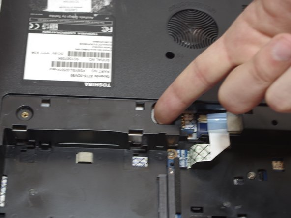 Using your finger or a spudger, push the optical drive out of its compartment so you can grab it.