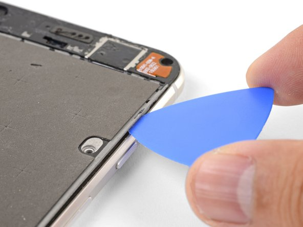 Insert an opening pick into the right edge of the phone and slide it upwards towards the top right clip.