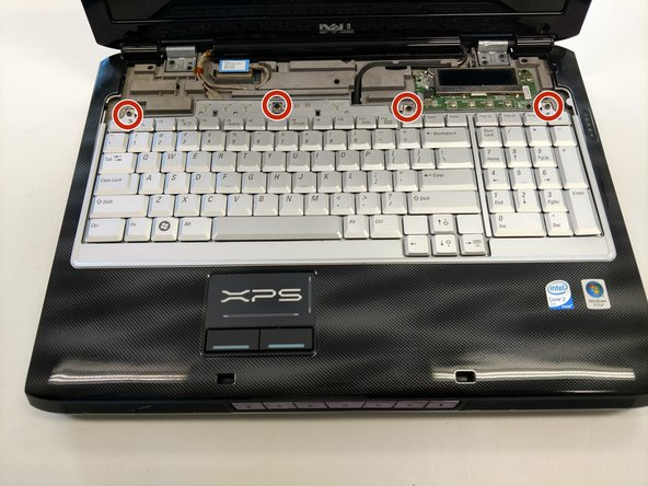 Remove the four screws from the top of the keyboard bracket.