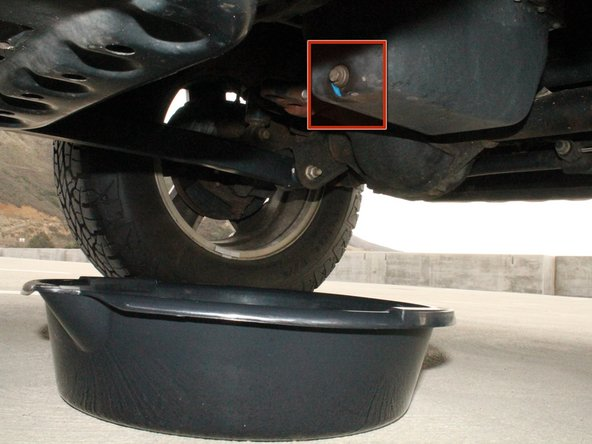 Place the oil drain pan underneath the vehicle.