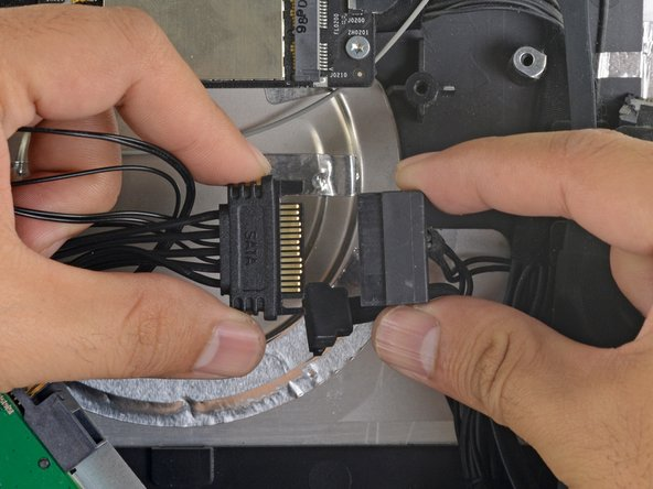 Connect the iMac's SATA power cable to the other end of the new sensor-enabled SATA cable.