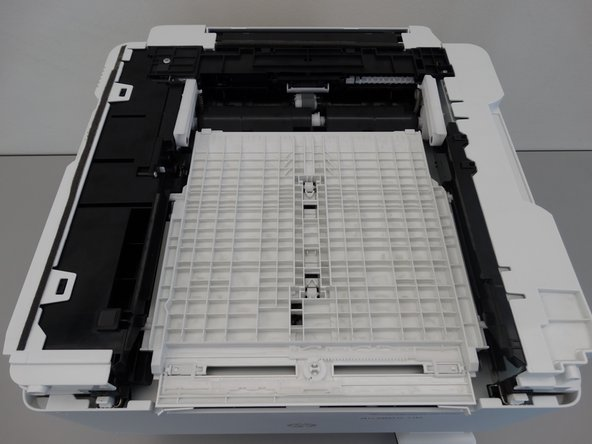 Turn the printer upside down.