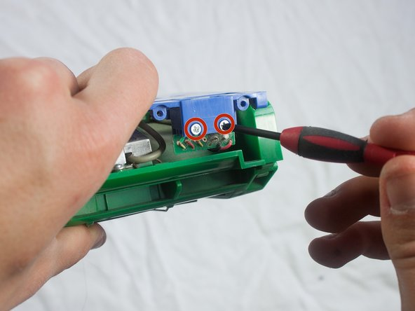 Use a Phillips #1 screwdriver to remove the two 1.5mm screws securing the chip in place.