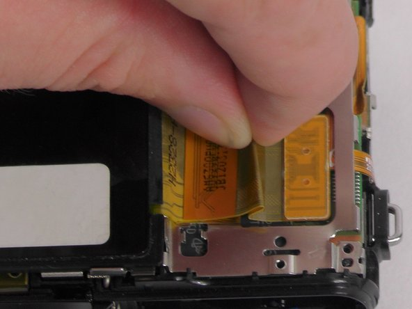 Use the tweezers to gently pull the yellow control board ribbon cable out of its connector.