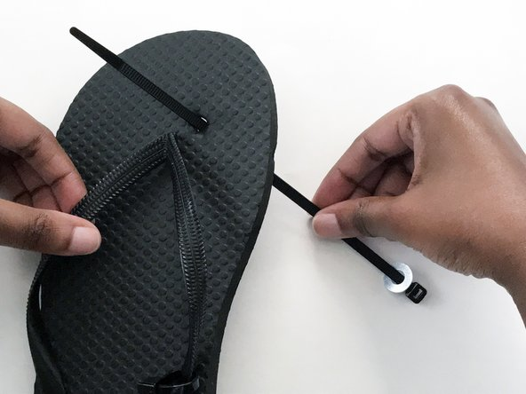 Pass the tail end through the hole on the bottom of the flip-flop.