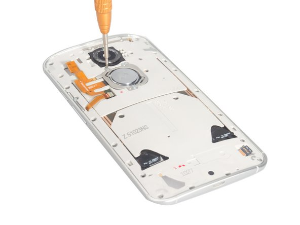 Remove the logo, as the flex cable under the logo is fastened to the back of the battery. This can be done by removing the three surrounding  screws, and then prying off the structure that encapsulates the logo.