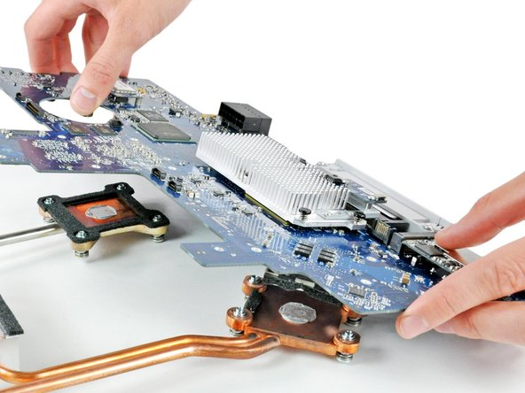 Lift the logic board off the heat sinks.
