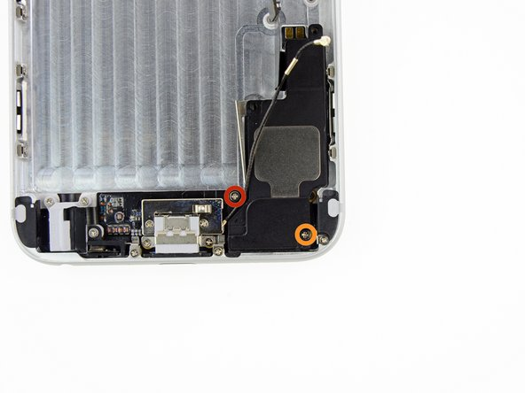 Remove the following screws securing the speaker to the rear case: