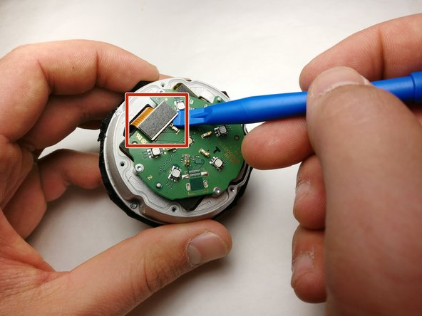 Gently pry the plug off the port on the circuit board with a plastic opening tool.