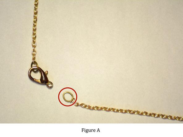 Look closely at where the necklace chain came apart. You will see a split ring, otherwise known as a jump ring.