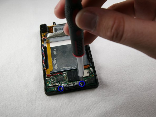 Remove the two T4 screws that hold the charging port on the bottom of the device.