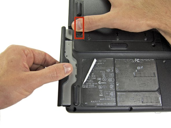 Slide the release switch for the optical drive toward the back of the 700m, and remove the optical drive.