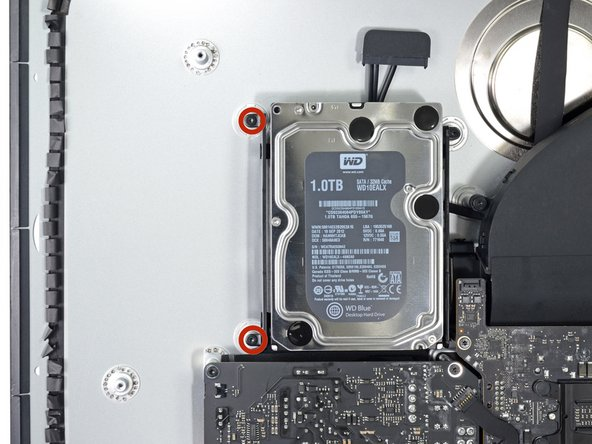 Remove two 7.3 mm T10 screws securing the left hard drive bracket to the rear case.
