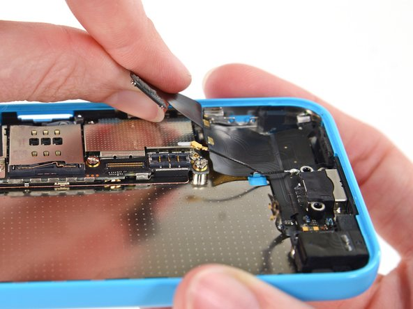 Gently peel the Lightning connector assembly up from the rear case.