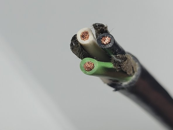 Examine the 3 wires inside. You should see green, white, and black. Snip off any stray wires over a trash can.