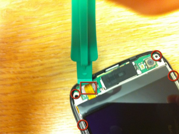The opening device was used to remove the connector for the display from the system board.