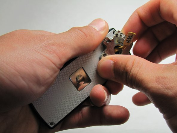 Using a generous amount of force, use your hands to pry loose the casing from the LCD panel.