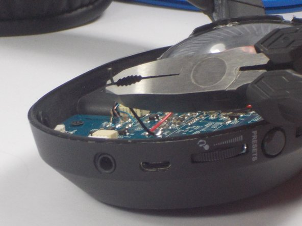 Use wire strippers to strip a portion of the rubber colored coating on the wires about a quarter inch long from both the wires connected to the circuit board and the two red and blacks wires connected to the new speaker.