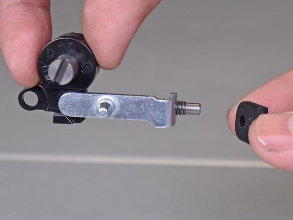 Slide the shaped plastic bearing onto the end of the assembly.