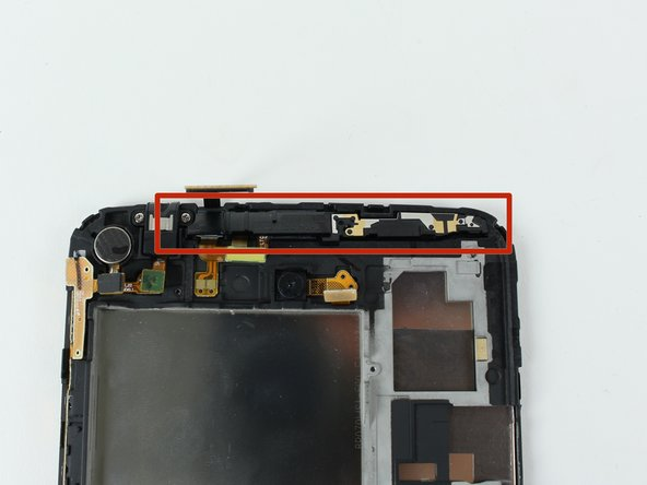 Begin removing the front camera by popping off the plastic stopper shown in the first picture.