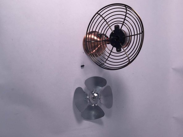 As seen  in the photograph to the left,   the blade of the fan has been removed from its guard.