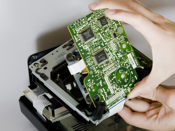 Carefully remove the CD tray from circuit board.