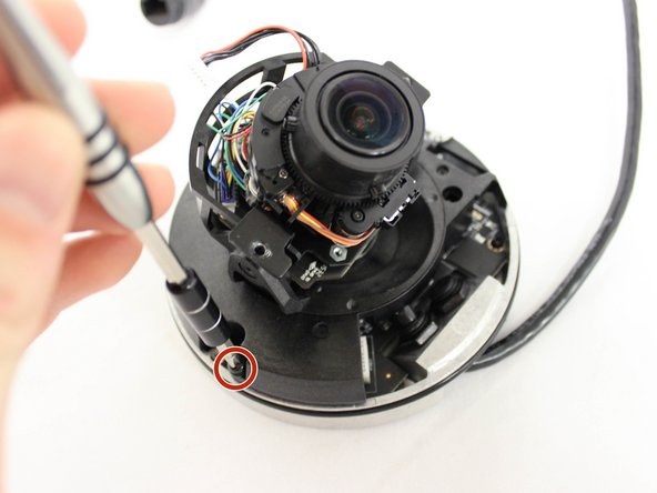 Using a PH1 screwdriver, remove the two 8mm screws holding the plastic base  to the metal base of the camera.