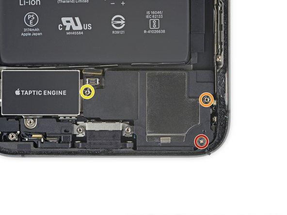 Remove the three screws securing the speaker: