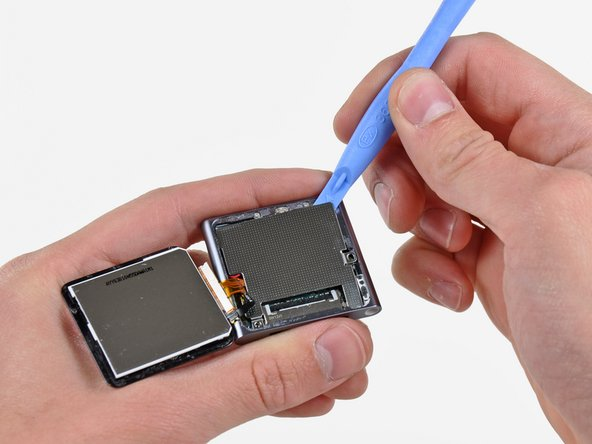 Use an iPod opening tool to pry the steel shield out of the Nano by its upper right corner.