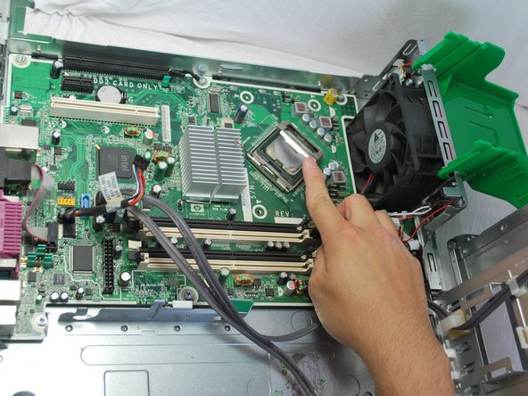 Using your index finger, lift up the bracket surrounding the CPU.
