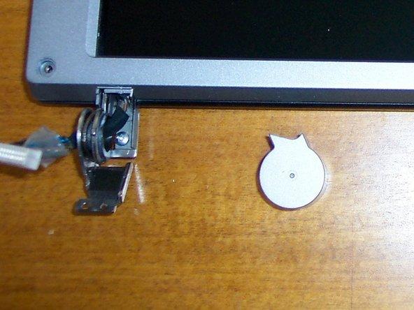 Remove 4 bezel screw covers. Remove 4 screws.