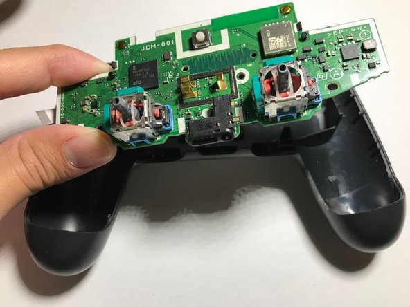 Remove the second layer PCB. This simply pops out of place.