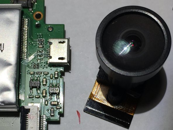 I couldn't quite make out the writing on the bottom of the camera module nor could I find anything similar online.