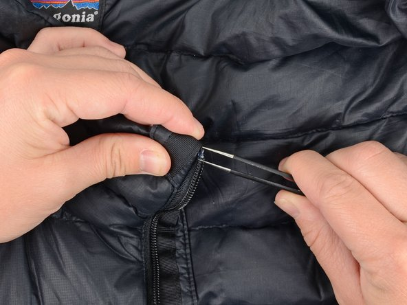 Carefully remove any remaining pieces of the stop using tweezers.