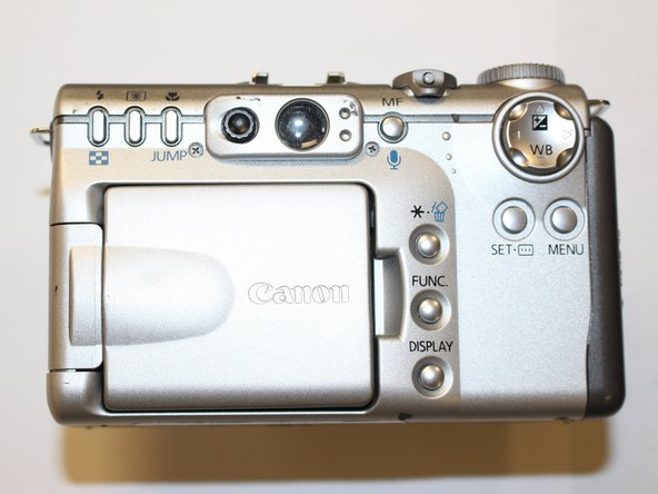 Start to remove all of the screws around the camera: from the front, back, sides, and bottom.