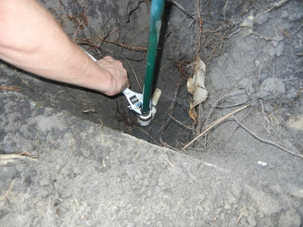 Unscrew the sprinkler  extension from the pipe fitting.