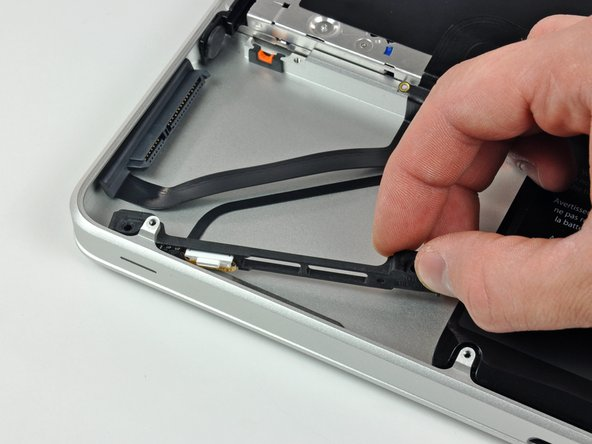 Slide the hard drive and IR sensor bracket away from the edge of the upper case.
