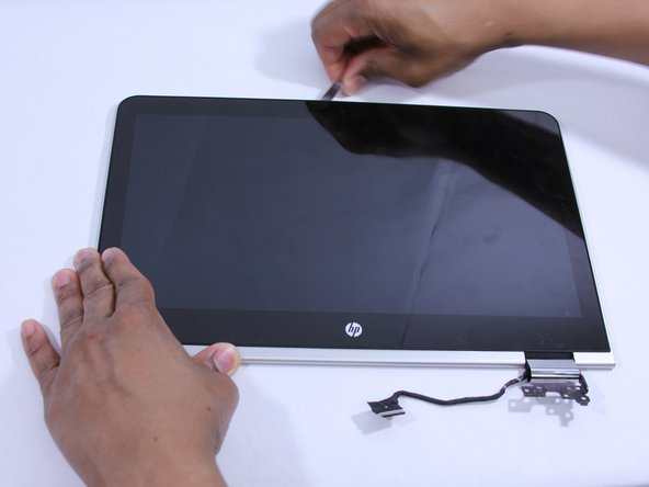 Use a Metal Spudger to pry  the display panel from the outer casing.