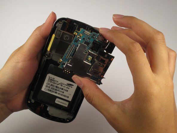 Lift and remove the motherboard from the device.
