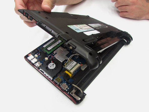 The computer should be open with the motherboard exposed and internal components exposed. You should now be able to access the Fan and RAM. There are more necessary steps to follow before accessing the screen and keyboard.
